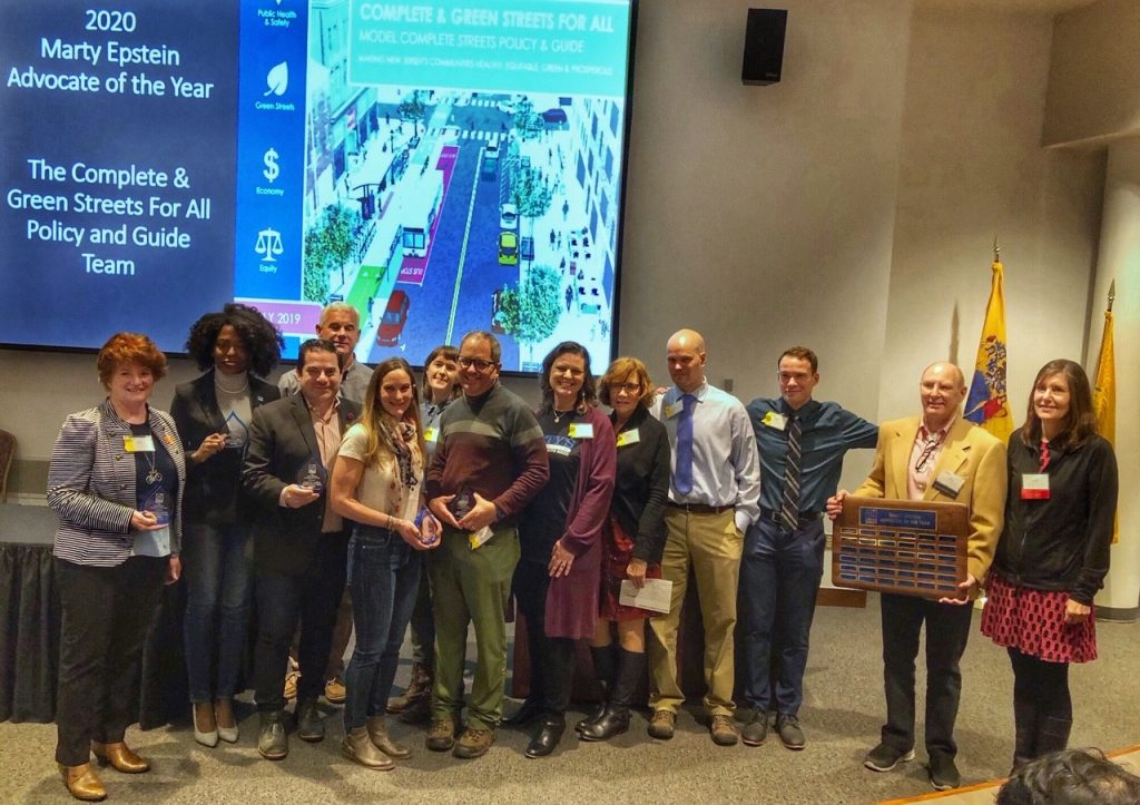 RideWise staff member Linda Rapacki and the Complete & Green Streets For All Policy & Guide Team receiving the Marty Epstein Award